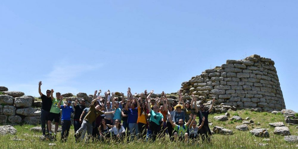 Spanish teenagers visiting the nuraghe